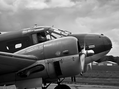 Black and white picture of propeller plane